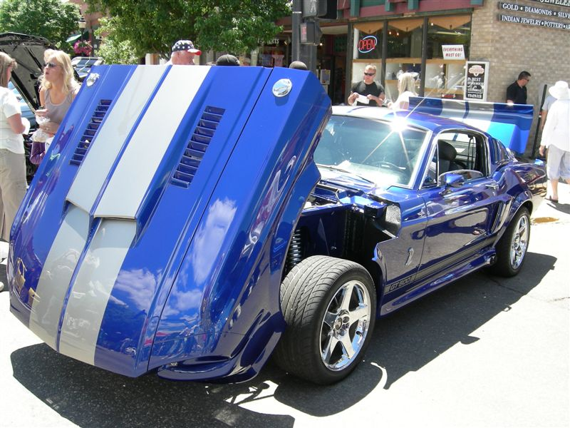 I have had so many questions re:this restomod I thought I would post a link to the shop that built it.  You can email them directly with your questions.    http://coloradomustang.com/